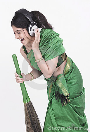 Sweeper singing into her broom