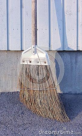 Sweeping brush on pavement