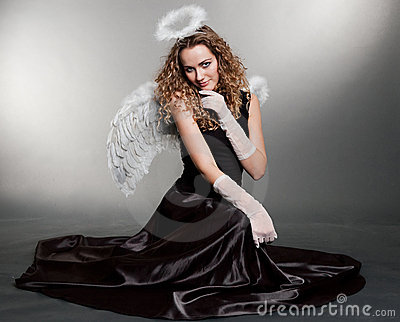 Sweet angel sitting on the floor