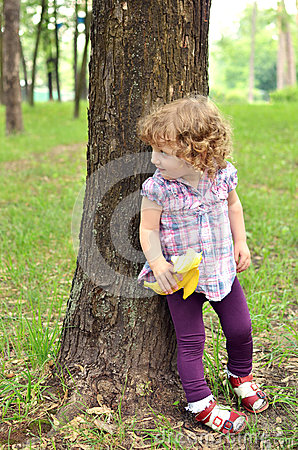 Free Sweet Baby Girl Hiding Behind The Tree Royalty Free Stock Image - 39741476