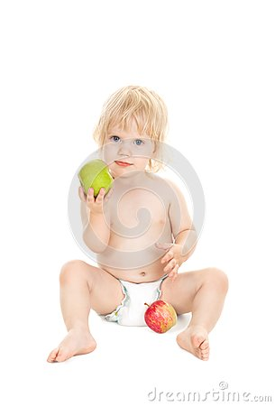 Sweet baby girl holding a green apple