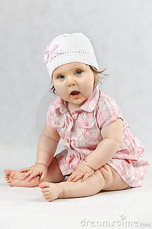 Sweet baby in white cap