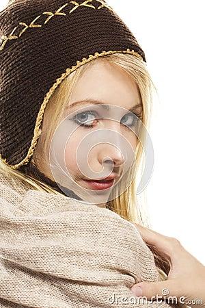 Sweet beautiful blonde woman wearing winter fashio