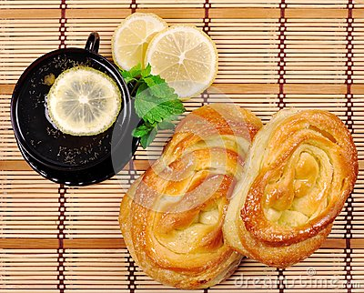 Sweet buns, lemon and tea