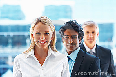 Sweet business woman with colleagues behind her