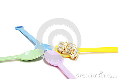 Sweet cashew nut with sesame on colorful spoon