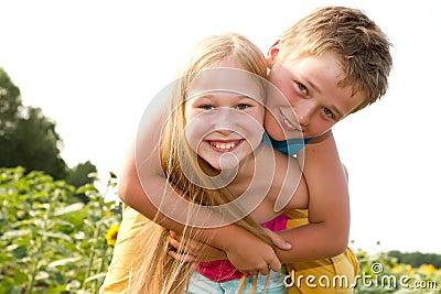 Sweet children in sunflower field