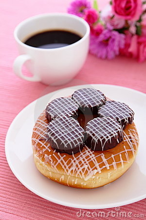 Sweet chocolate donut with a cup of coffee