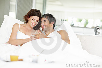 Sweet couple lying on bed comfortably