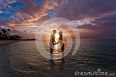 Sweet couple sunset beach