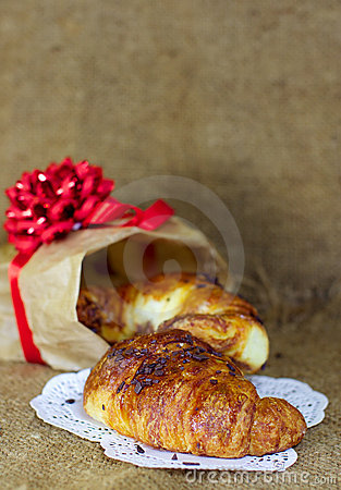 Sweet croissants with chocolate Christmas present