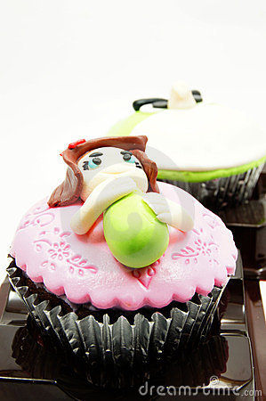 Sweet cup cake with a funny figure
