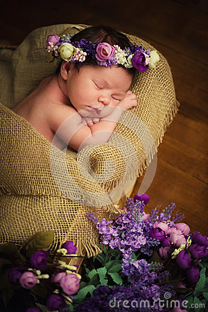 Free Sweet Dreams Of Newborn Baby. Beautiful Little Girl With Lilac Flowers Royalty Free Stock Photography - 67172597