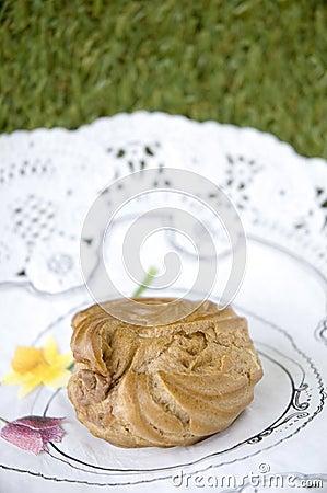 Sweet eclair in garden