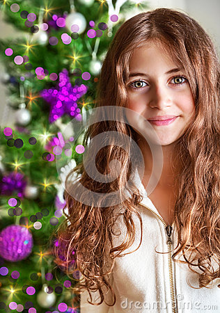 Free Sweet Girl Portrait Near Christmas Tree Stock Images - 35240524