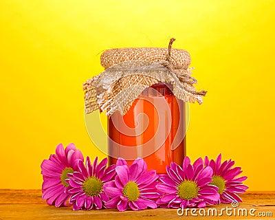Sweet honey in jar on wooden