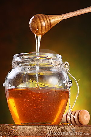 Free Sweet Honey Pouring From Drizzler Into The Pot Royalty Free Stock Image - 17413636