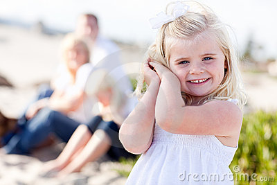 Sweet Little Blonde Girl Having Fun At Beach