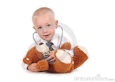 Sweet Little Boy Caring for His Teddy Bear