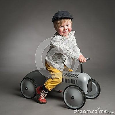 Sweet little boy driving a retro car