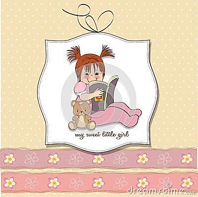 Sweet little girl reading a book