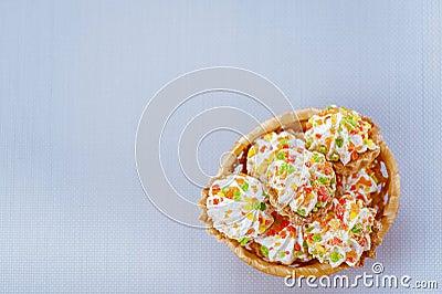 Sweet muffins in wicker basket