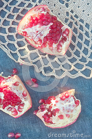 Sweet pomegranate on the lacy placemat