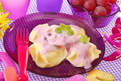 Sweet ravioli with blueberry yogurt