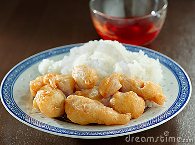 Sweet and sour chicken with dipping sauce.