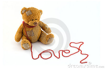 Sweet teddy bear with a string of red beads