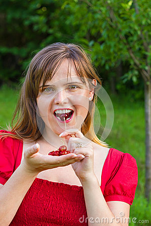 Free Sweet Woman Eating Cherries Stock Images - 26249154