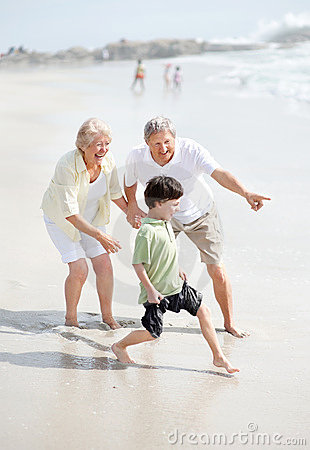 Sweet young boy playing with his grandparents