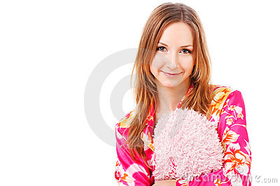 Sweet young girl in pink pajamas on bed