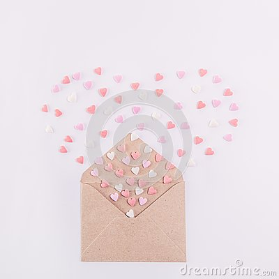 Free Sweets Sugar Candy Hearts Fly Out In The Form Of Heart From Craft Paper Envelope On The White Background . Valentine Day Concept. Stock Photography - 105902182