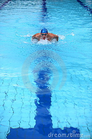 Swimmer in blue  swimming pool