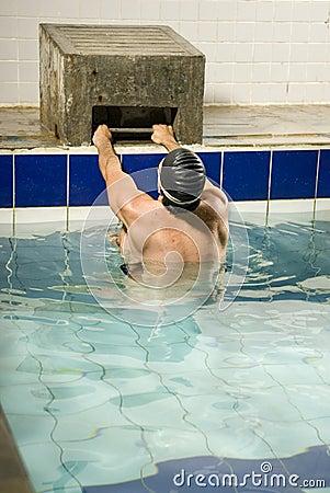 Swimmer Holding onto Block