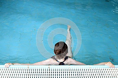 Swimmer relaxing in pool