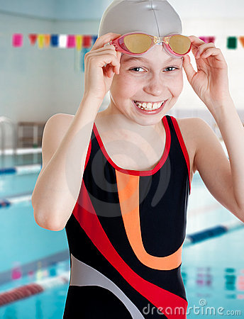 Swimmer on start in school swimming pool