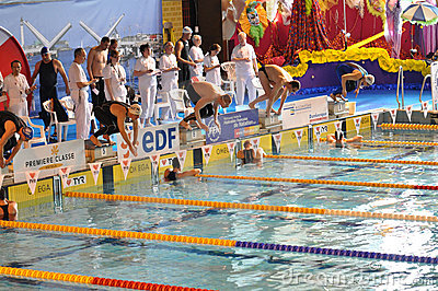 Swimmers starting diving into the swimming pool Editorial Stock Photo