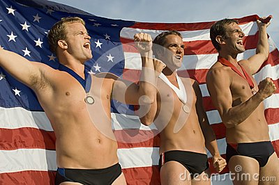 Swimming Champions Cheering With Clenched Fists