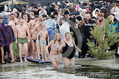 Swimming in the ice-hole. Feast of the Epiphany Editorial Photo