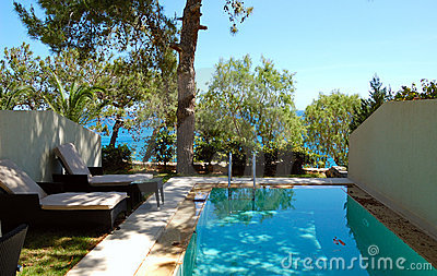 Swimming pool at apartment by luxury villa
