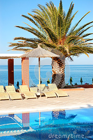 Swimming pool by a beach at the modern luxury hotel
