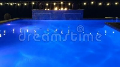 Swimming Pool With Blue Colored Lights, Waterfall, Flames And Lights stock video footage