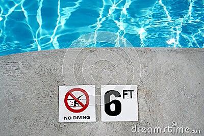 Swimming pool depth marker