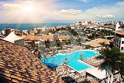 Swimming pool on hotel. Sunset in Tenerife island, Spain. Tourist Resort