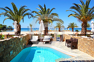 Swimming pool by luxury villa with beach view