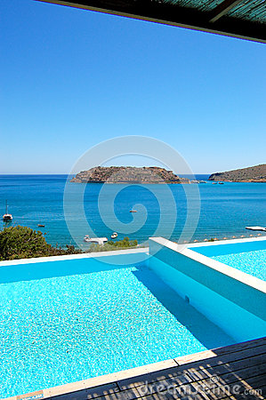 Swimming pool by luxury villa with a view on Spinalonga Island