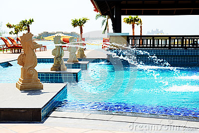 The swimming pool near beach in Thai style hotel on Palm Jumeira