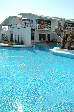 Swimming pool near villa at luxury hotel